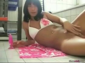 Sexy latina babe GF masturbates in bathroom with a dildo